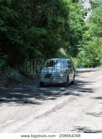 GOLA DEL FURLO, ITALY - MAY 19: FIAT 1100/103 BERLINA 1953 on an old racing car in rally Mille Miglia 2017 the famous italian historical race (1927-1957) on May 19 2017