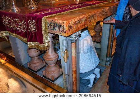 The Altar of the Crucifixion at the Church of the Holy Sepulchre in the old city of Jerusalem, Israel. The 12th station of the cross where it was installed during Christ's crusifixion