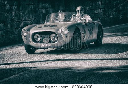 GOLA DEL FURLO, ITALY - MAY 19:MARINO (BRANDOLI) FIAT 1100 SPIDER 1955 on an old racing car in rally Mille Miglia 2017 the famous italian historical race (1927-1957) on May 19 201