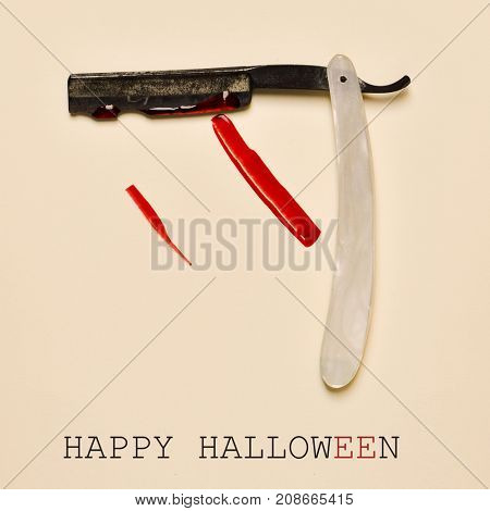 an old and rusty straight razor full of blood and the text happy halloween on an orange background