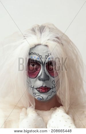 portrait of a bride with a mexican calaveras makeup