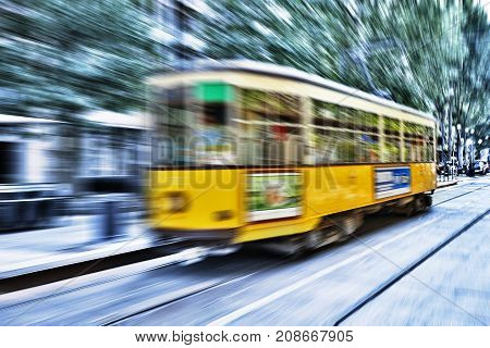 Blurred Movement Of A Old Vintage Orange Tram