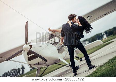 Couple Near Plane