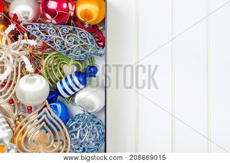 Christmas Decoration In The Box On Wooden White Backround. Winter Holidays Concept. Space For Text.