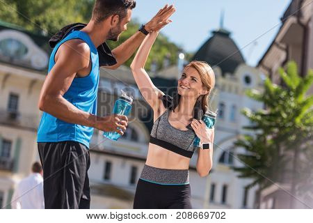 Sports Couple Giving Highfive