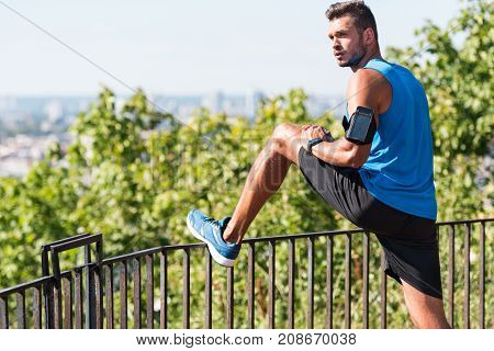 Sportsman Stretching In Park