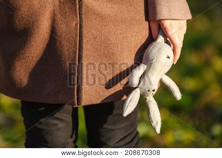 Mental Disorder Concept. Young Childlike Woman Holding Toy Rabbit
