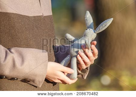 Young Woman With Toy Rabbit At Fall  Park