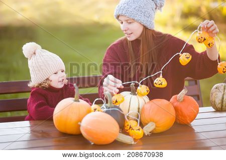 Mother And Child Choosing Pumpkins For Jack-o-lantern