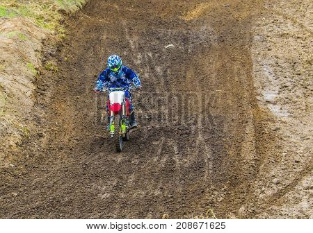 Extreme Sports On Motorcycles. A Rider On A Motorcycle Rides The Sand. Sport