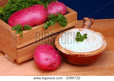Mashed Potatoes And Crate Of Red Spuds