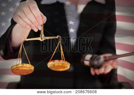 Close-up of American flag against midsection of woman holding scales of justice and gavel