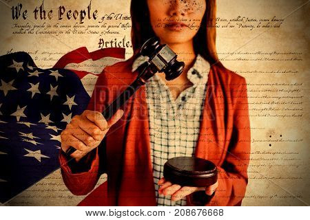Businesswoman banging a law hammer on the gavel against declaration of independence