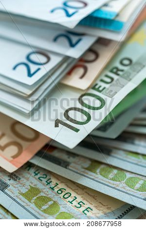 Euro and USA dollar money banknotes background wealth concept