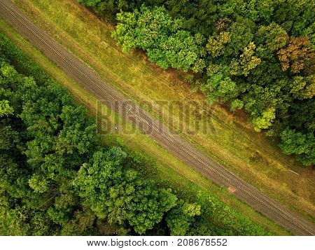 View from height to a railway surrounded by forest