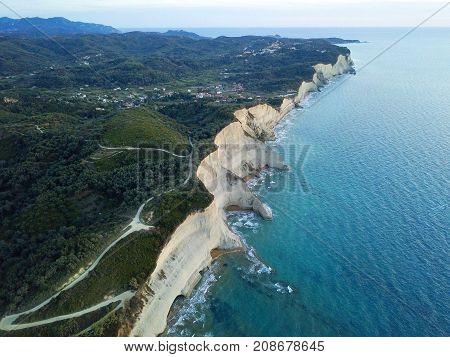Aerial photo of coastline at Corfu island in Greece at sunset. Beautiful sea landscape