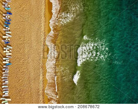 Top view of the beach and sun loungers. The deserted coast of the Ionian Sea Greece Corfu