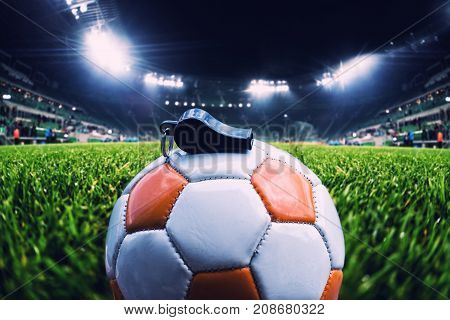 Football Ball With Whistle On The Grass On Soccer Stadium, Vintage Effect