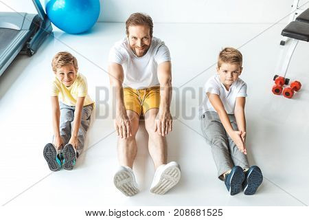 Father With Sons Exercising Together