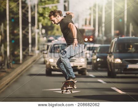 Pro Skater Doing Tricks And Jumps On Street. Free Ride