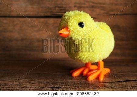 Little Decorative Chicken On Wooden Background