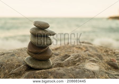 Pebble tower on the seaside. Concept of meditation