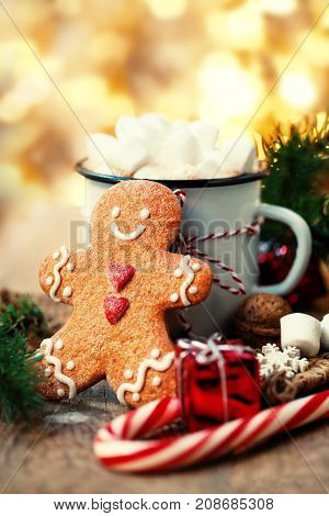 Christmas Card with Hot chocolate with marshmallow gingerbread man cookie fir tree branches xmas holiday decorations