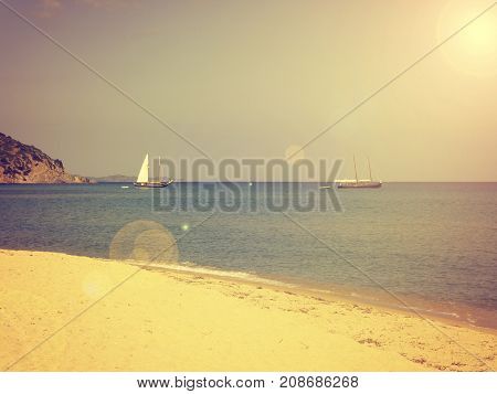 Vacation or travel background lonely beach with two boats vintage or retro color stylized