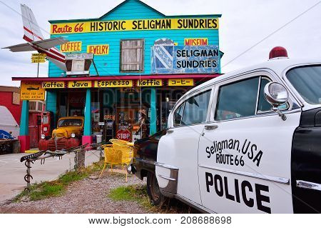 Chrysler Police Car In Front Of Historic Seligman Sundries Cafe.