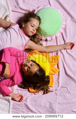 Schoolgirls In Pink Pajamas Sleep On Colorful Pillows, Top View