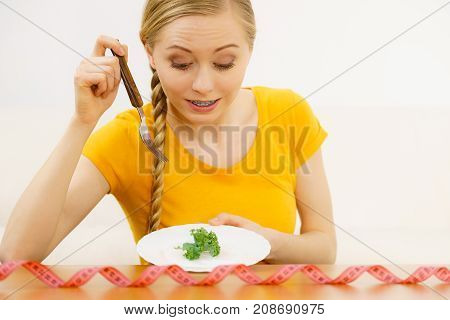 Woman On Diet Holding Plate With Lettuce