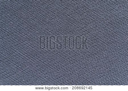 background of knitted texture of fabric of silvery color or knitwear closeup
