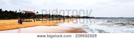 Negombo Sri Lanka. Beach at Negombo Sri Lanka with evening cloudy sky. Boats and few unidentified people