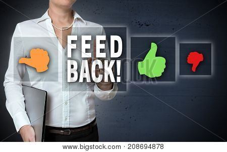 Feedback and thumb touchscreen is shown by businesswoman.