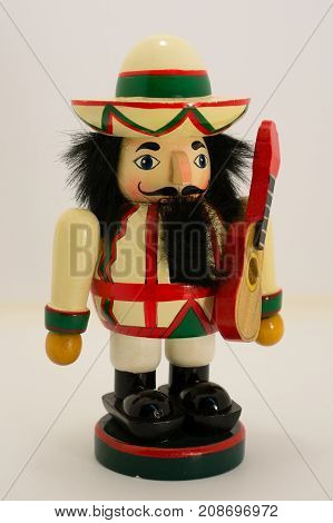 an isolated Mariachi Nutcracker with a guitar