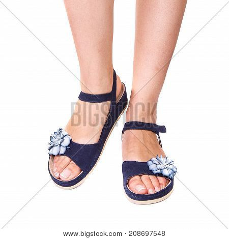 Legs Of A Girl Orthopedic Shoes On White Isolated Background