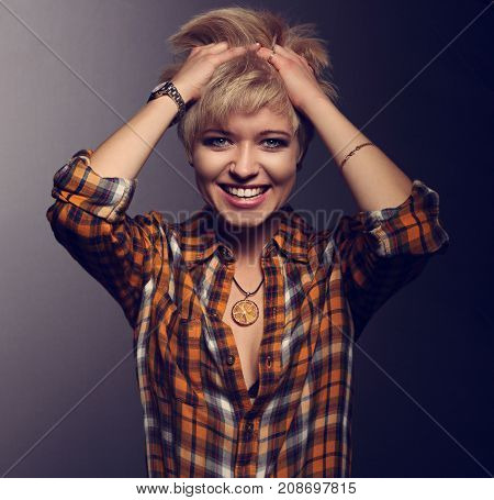 Happy Enjoying Blond Young Short Hairstyle Model Laughing In Bright Yellow Sell Shirt Holding The Ha