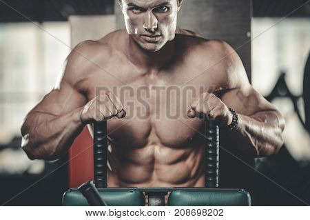 Handsome Model Young Man Posing In Gym