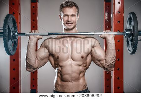 Brutal Caucasian Bodybuilder Training Shoulders In Gym..