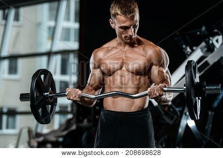 Handsome Model Young Man Working Out In Gym