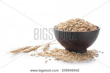 Bowl and oatmeal flakes on white background