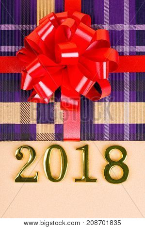 Gift with a red bow and figures 2018