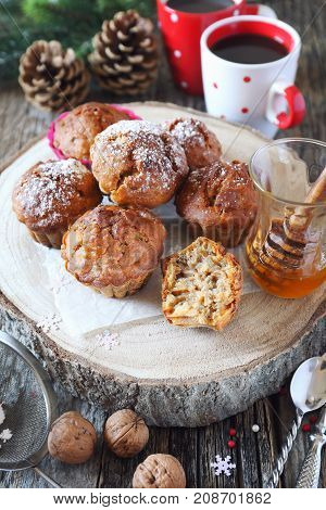 New Year pastry: spiced honey muffins with walnuts two cups of coffee and pine cones