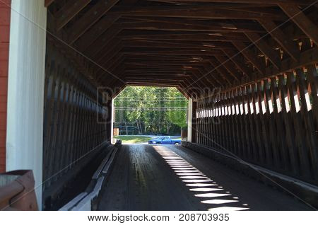 A wooden red covered bridge in Vermont