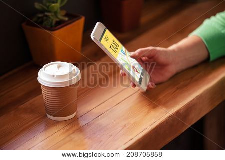 Vector image of Pay taxi text with map against woman hand using smart phone at table