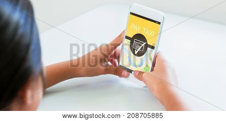 Digitally generated image of Pay Taxi text with map against woman using phone at table