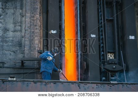 Coke Furnace. Production Of Coke. Steel Works. The Person Loads Coke In The Furnace. The Heated Coal