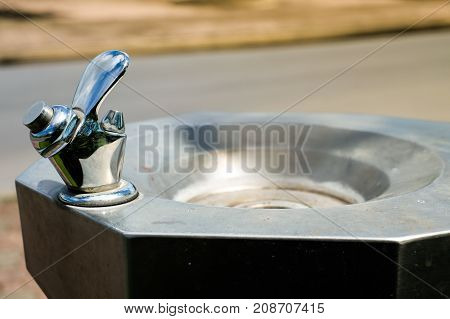 Public water drinking faucet with sink set on the street for object background or texture .