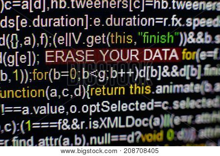 Macro photo of computer screen with program source code and highlighted SPYWARE inscription in the middle. Computer script on the screen with virus in it. Cyber security concept.