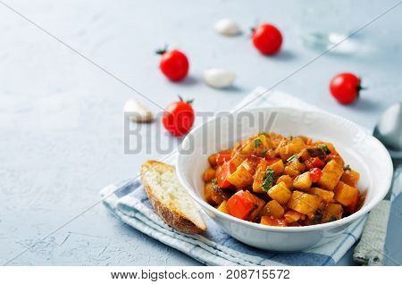 Eggplant potato Bell pepper goulash on a stone background